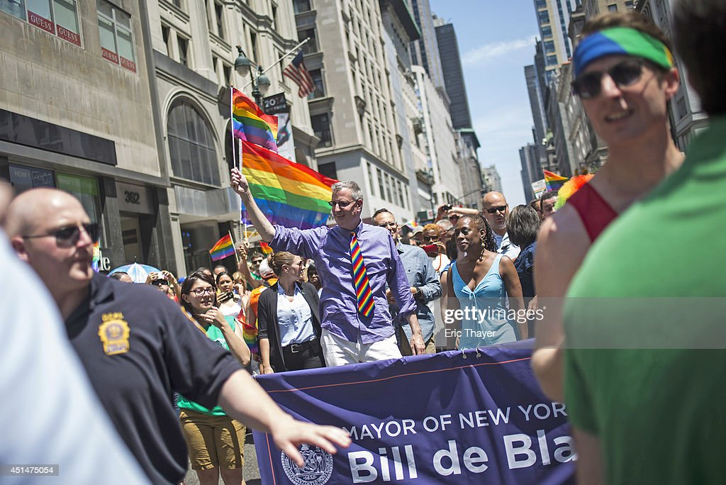New York City's Mayor Bill de Blasio and his wife Chirlane McCray walk down 5th Avenue during the 2014 Gay Pride March on June 29, 2014 in New York City. Thousands of marchers attended the parade route, which started at 36th Street and Fifth Avenue and ended at Greenwich and Christopher streets. The parade ended at the Stonewall Inn, where New York marchers commemorated the 45th anniversary of the 1969 riots, which are credited with launching the modern gay rights movement. New York Gov. Andrew Cuomo was also in attendance along with grand marshals Laverne Cox, transgender actress and activist, actor Jonathan Groff and Rea Carey, Executive Director of the National Gay and Lesbian Task Force.