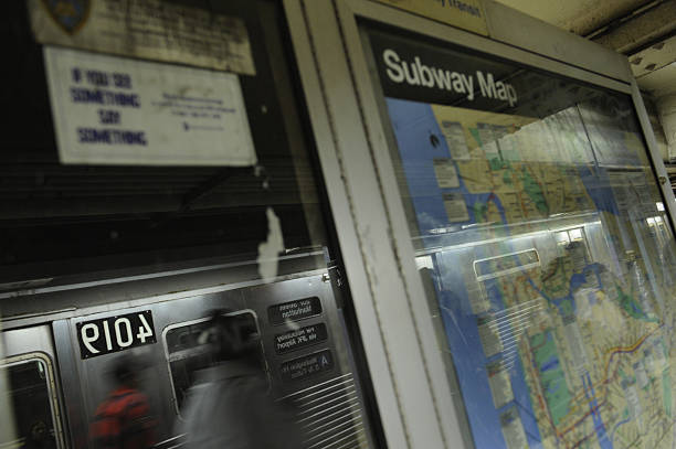 New York Subway Map 2008.New York Commuters Walk Past A Subway Ma Pictures Getty Images