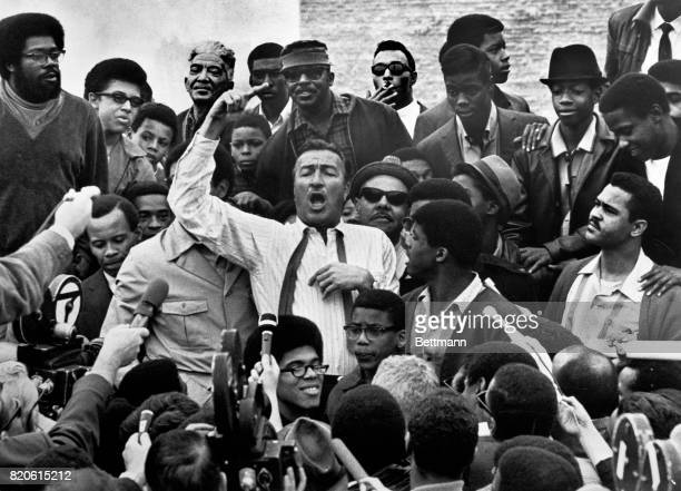 New York Congressman Adam Clayton Powell surrounded by black students at UCLA while addressing the media after having spoken on campus January 10 1968