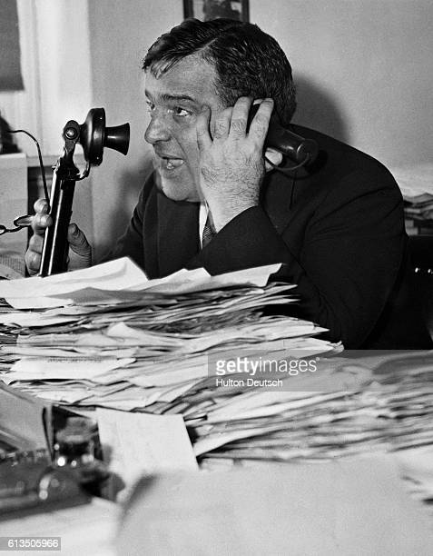 New York Congressman Fiorello LaGuardia speaks on the phone with Senator Clarence Dill They are discussing a sales tax 1932