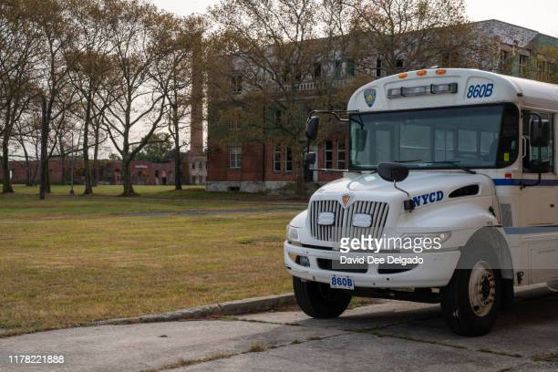 New York Corrections Department bus is parked on the grounds of Hart Island a former prison and Nike missile silo site which is now the largest...