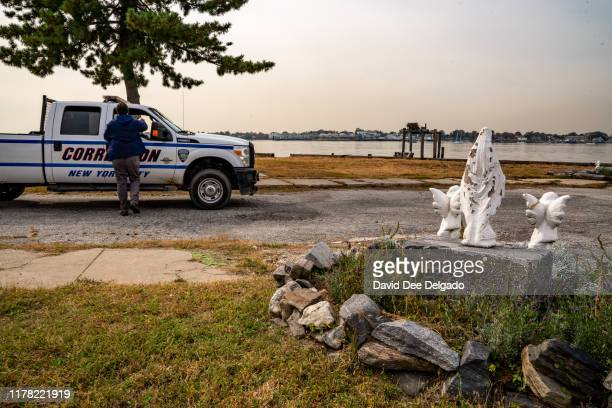 New York Corrections Department employee works on the grounds of Hart Island a former prison and Nike missile silo site which is now the largest...
