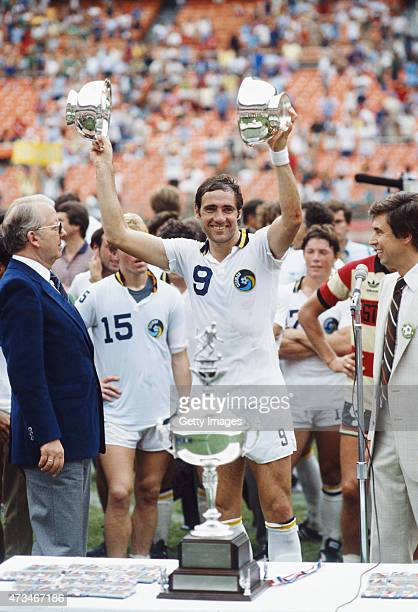 New York Cosmos captain Giorgio Chinaglia holds aloft two trophy's after the 1980 Soccer Bowl victory against the Fort Lauderdale Strikers at RFK...
