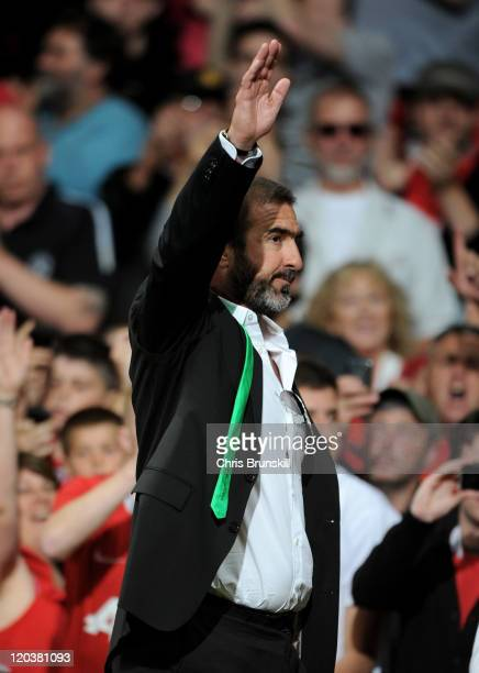 New York Cosmos Manager Eric Cantona salutes the fans at the end of Paul Scholes' Testimonial Match between Manchester United and New York Cosmos at...