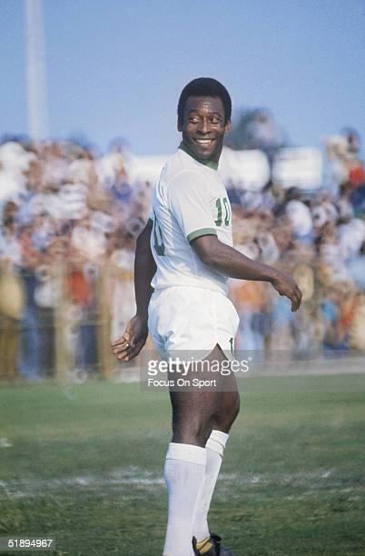 New York Cosmos' Pele walks across the field