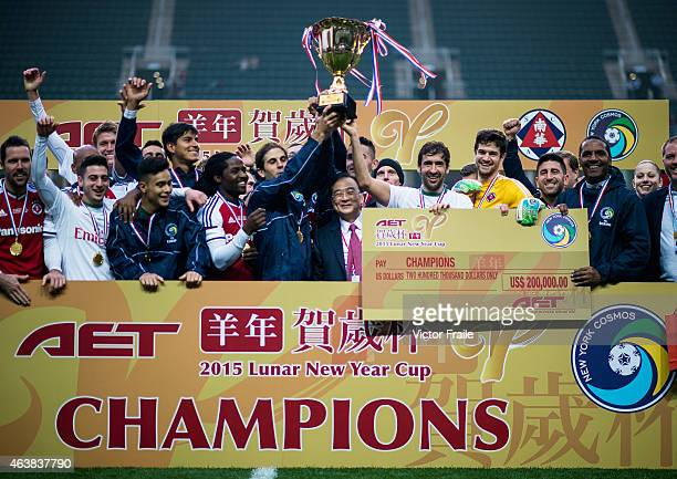 New York Cosmos players celebrate with the trophy after winning the 2015 Lunar New Year Cup match between South China and the New York Cosmos at Hong...