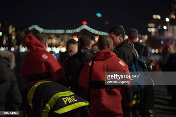 New York cost guard boats conduct a search and rescue operation after a helicopter crashed into New York City's East River on Sunday evening that...