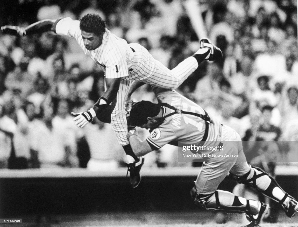New York Daily News prize photograph of the New York Yankees' Deion Sanders taking home as the Kansas City Royals' Mike Macfarlane attempts to stop him.