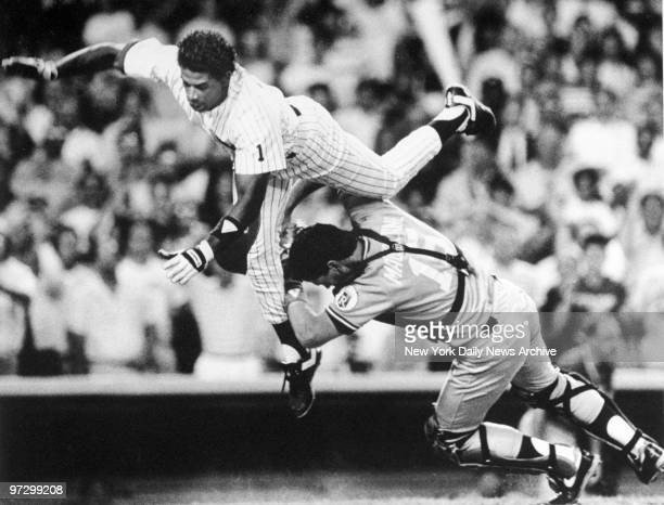 New York Daily News prize photograph of the New York Yankees' Deion Sanders taking home as the Kansas City Royals' Mike Macfarlane attempts to stop...
