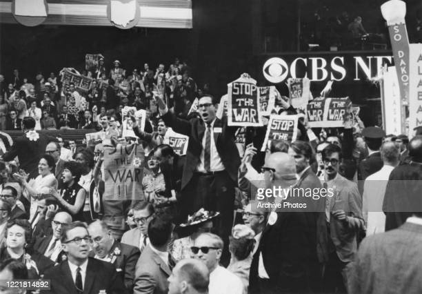 New York delegates holding 'stop the war' banners in protest at the USA's continued involvement in the Vietnam War on the third day of the 1968...
