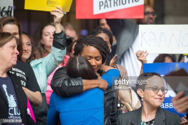 New York Democratic congressional candidate Alexandria OcasioCortez hugs Boston City Councilor and Democratic congressional candidate Ayanna Pressley...