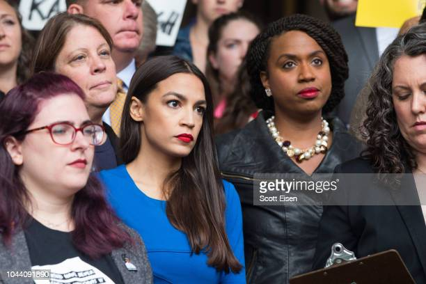 New York Democratic congressional candidate Alexandria OcasioCortez stands with Boston City Councilor and Democratic congressional candidate Ayanna...