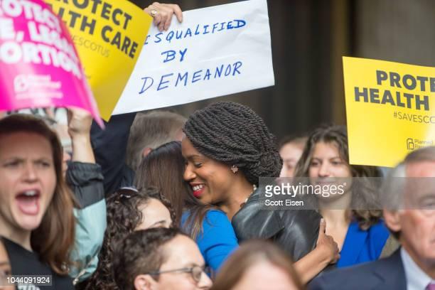 New York Democratic congressional candidate Alexandria OcasioCortez hugs Boston City Councilor and Democratic congressional candidate Ayanna Pressley...