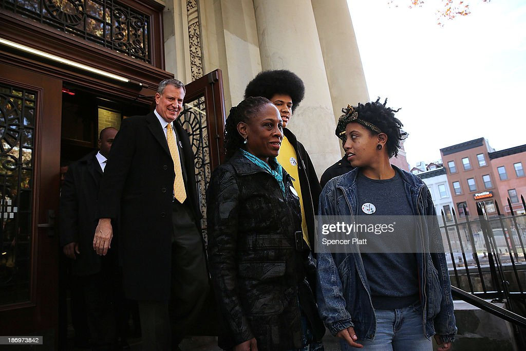 New York Democratic mayoral candidate Bill de Blasio and his family wife Chirlane McCray, daughter Chiara de Blasio and son Dante de Blasio walk out of their local precint after voting at a public library branch on Election Day on November 5, 2013 in the Brooklyn borough of New York City. De Blasio holds a significant lead in the polls over his challenger Republican mayoral candidate Joe Lhota.