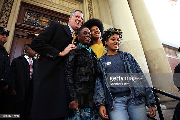 New York Democratic mayoral candidate Bill de Blasio poses with his family wife Chirlane McCray son Dante de Blasio and daughter Chiara de Blasio...