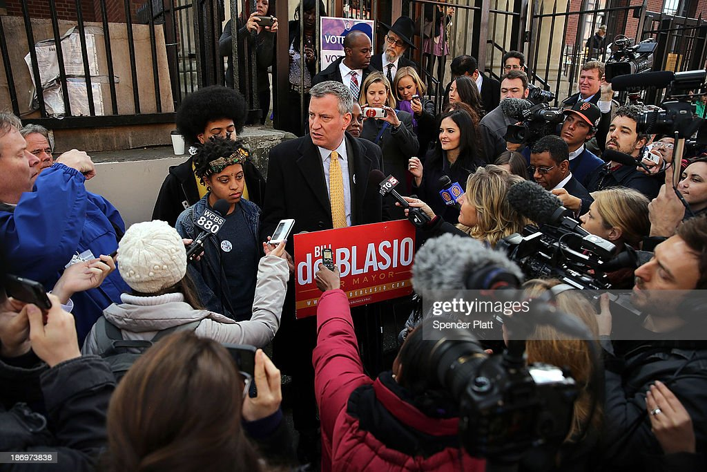 New York Democratic mayoral candidate Bill de Blasio speaks to the media with his family after voting at a public library branch on Election Day on November 5, 2013 in the Brooklyn borough of New York City. De Blasio has a double didgit lead over his challenger Republican mayoral candidate Joe Lhota.