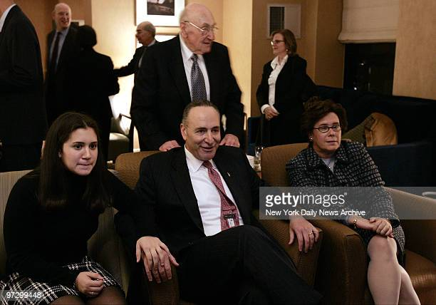 New York Democratic Sen Charles Schumer center watching returns on television with his family including from left his daughter Allison father Abe...