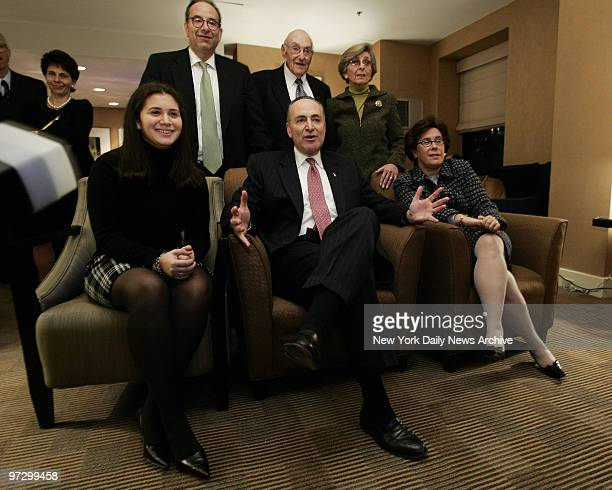 New York Democratic Sen Charles Schumer center watching returns on television with his family including from left his daughter Allison wife Iris...