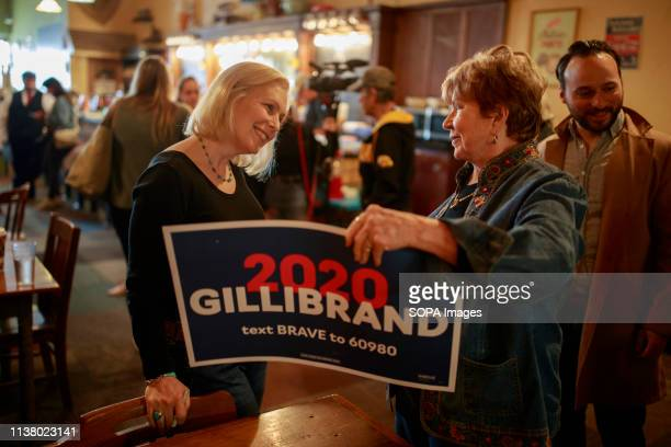 "New York Democratic Senator Kirsten Gillibrand campaigns for President of the United States as she speaks with a supporter during a ""listening tour""..."