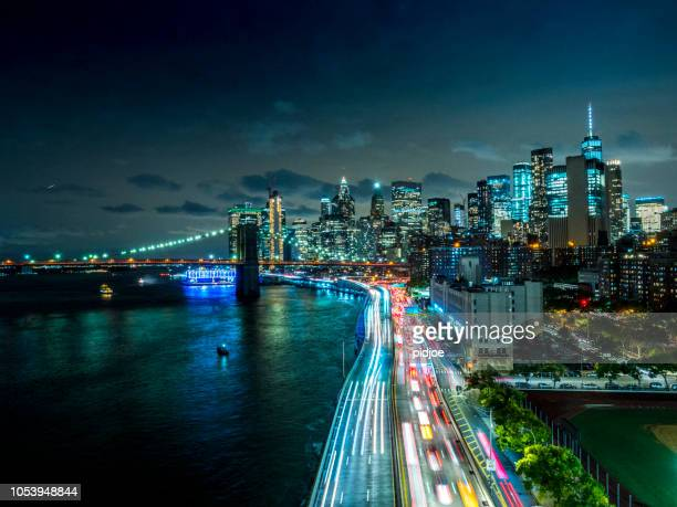 new york downtown skyline - aerial view after sunset - new york city stock pictures, royalty-free photos & images