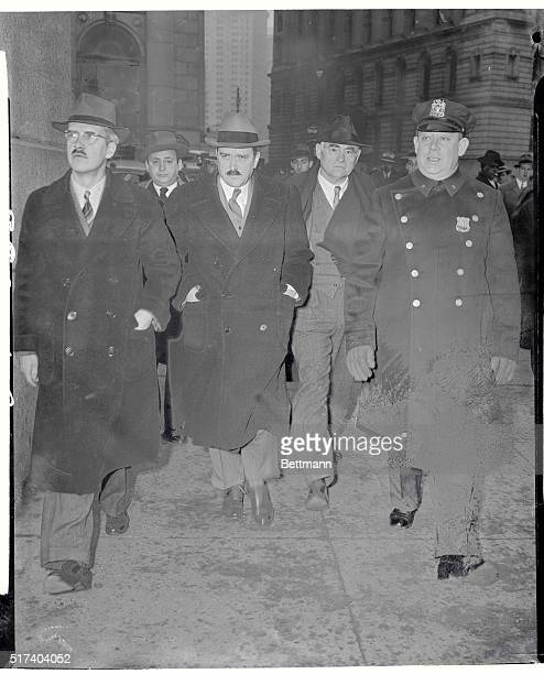 Earl Browder Starts Jail Sentence Earl Browder former secretary of the Communist Party of America is flanked by his brother William and Robert E...