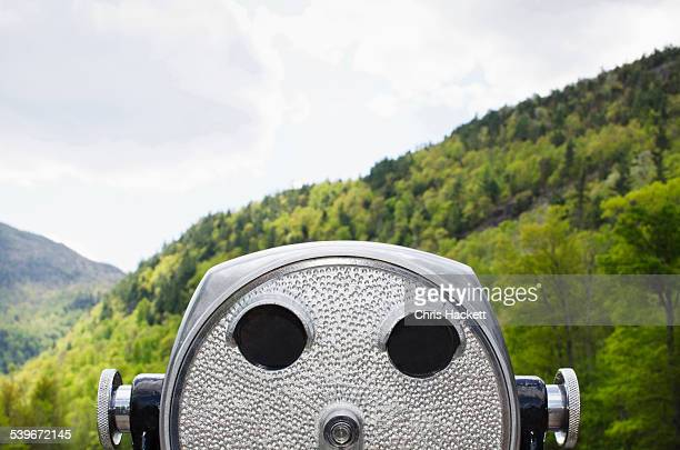 usa, new york, essex county, wilmington, close-up view of coin-operated binoculars against background of wooded adirondack mountains - hackett stock photos and pictures