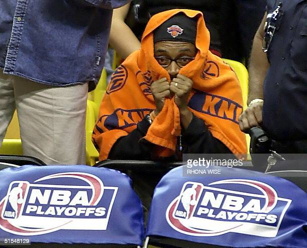 New York Film Director and Knicks fan Spike Lee sits behind the Miami Heat bench during the last minute of the Knocks-Heat game seven of the Eastern...