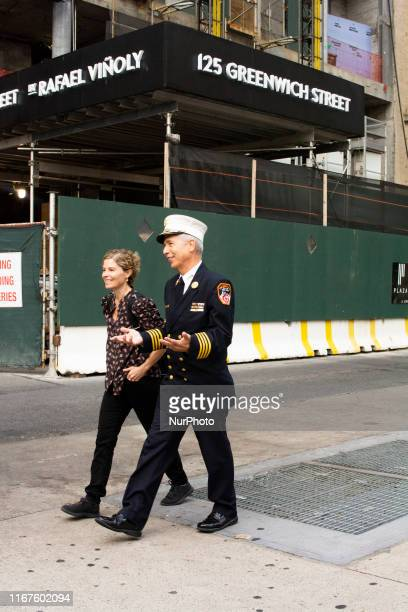 A New York Fire Department Capitan is seen walking to the September 11 Memorial Service