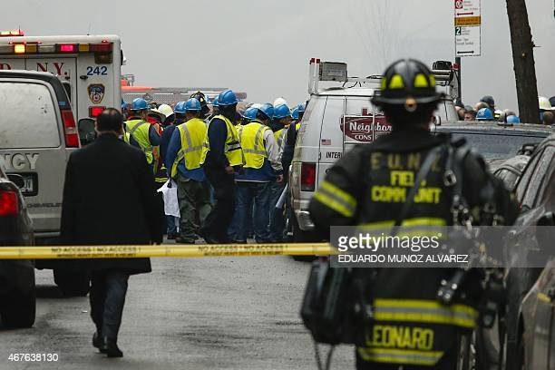 New York firefighters battle a blaze at a commercial and residential block on March 26 in New York's East Village The entire building at 125 Second...