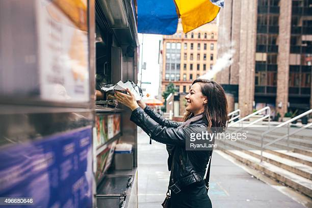 new york food cart customer - street food stock pictures, royalty-free photos & images