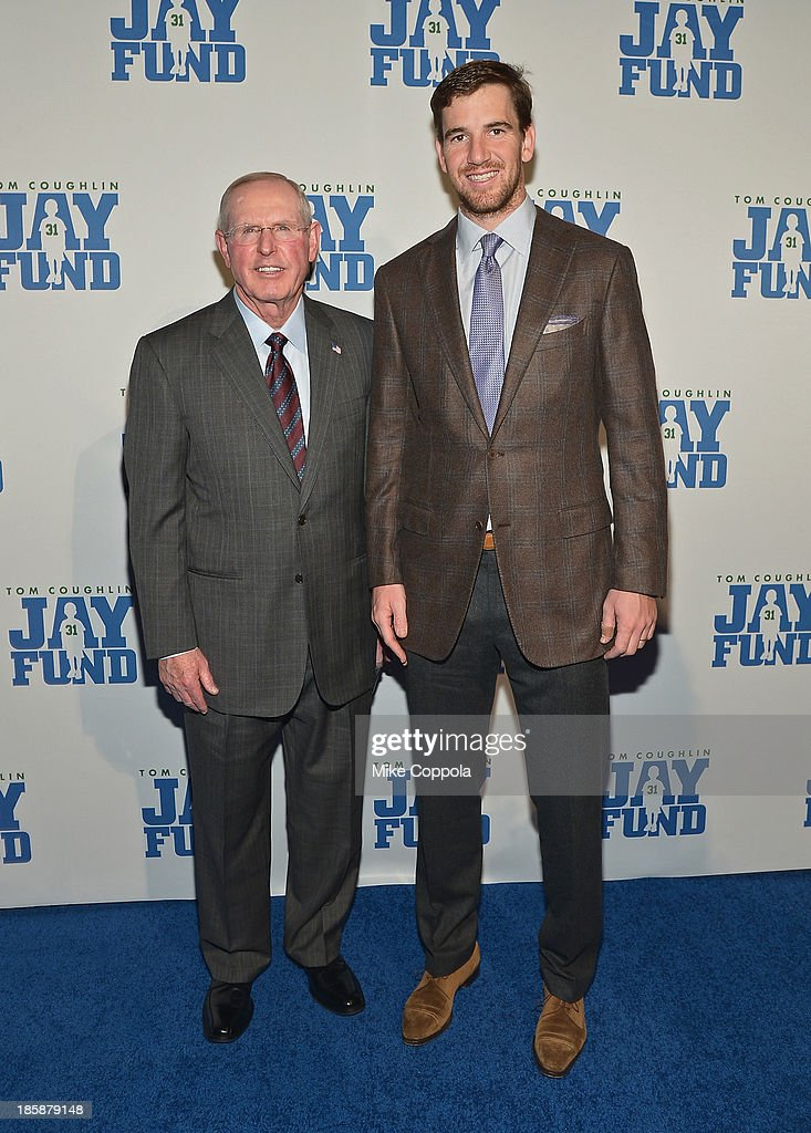 New York Football Giants head coach Tom Coughlin (L) and quarterback Eli Manning attend the Ninth Annual Tom Coughlin Jay Fund 'Champions For Children Gala' at Cipriani 42nd Street on October 25, 2013 in New York City.