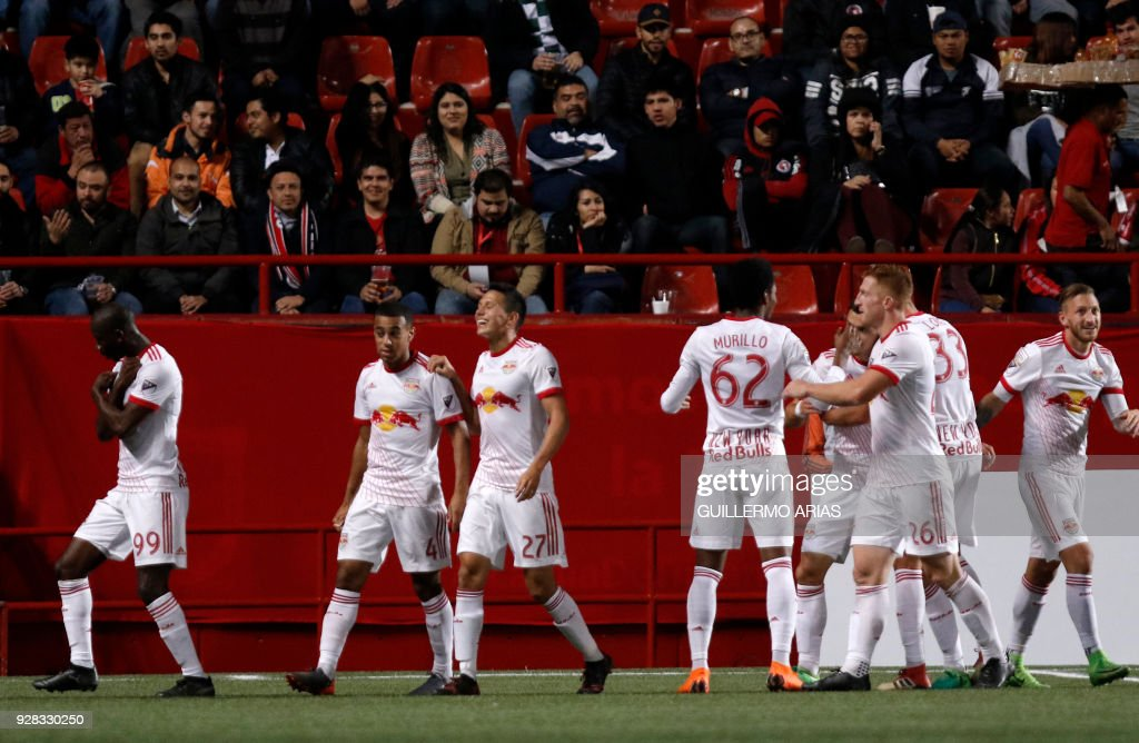 New York from United States players celebrate their second goal against Tijuana from Mexico during the first leg of the CONCACAF Champions League quarterfinals match at Caliente Stadium in Tijuana, Mexico on March 6, 2018. /