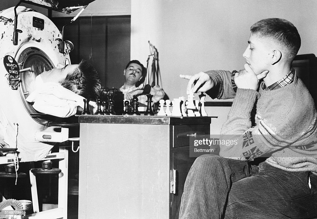 Iron Lung Patient Playing Chess with Bobby Fischer : News Photo