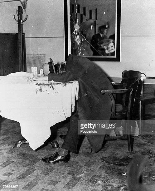 New York gangster Arhur Flegnheimer known as Dutch Schultz lies dead on a restaurant table where he was killed