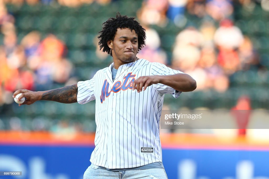 New York Giant first round pick Evan Engram throws out the first pitch prior to th egam ebetween the New York Mets and the Washington Nationals at Citi Field on June 15, 2017 in the Flushing neighborhood of the Queens borough of New York City.