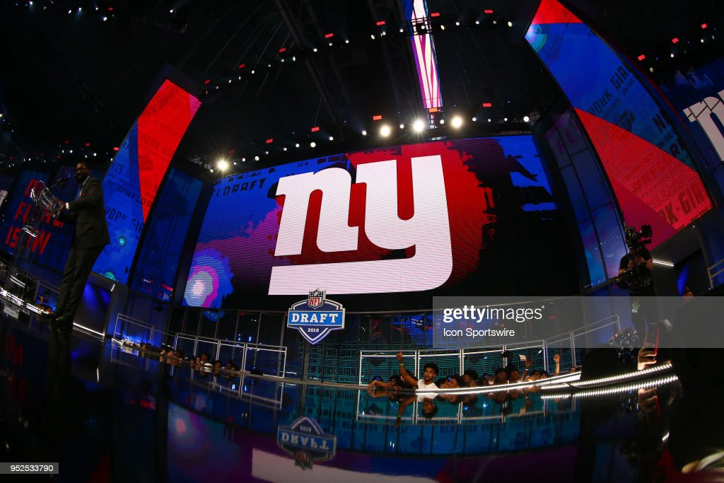 New York Giant logo on the video board during the third round of the 2018 NFL Draft on April 27, 2018, at AT&T Stadium in Arlington, TX.