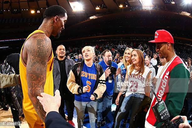 New York Giant Victor Cruz Singer Miley Cyrus along with her mother Tish Cyrus and sister Noah Cyrus talk to JR Smith of the Cleveland Cavaliers...