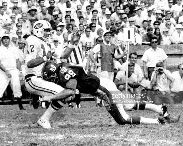 New York Giants against the New York Jets Joe Namath rushed on long pass by Giant rookie Fred Dryer who was called for roughing the passer