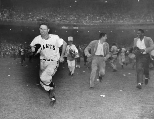 New York Giants' captain Alvin Dark runs off field as he hea