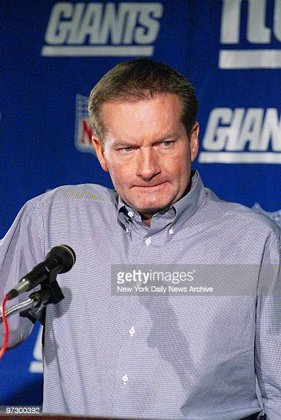 New York Giants' coach Jim Fassel looks grim during news conference at Giants Stadium as he discusses yesterday's 2421 loss to the Eagles which...