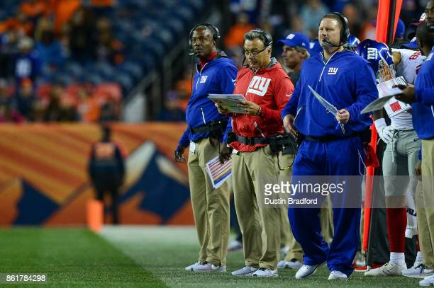 New York Giants coaches including head coach Ben McAdoo and offensive coordinator Mike Sullivan look on in the fourth quarter of a game against the...