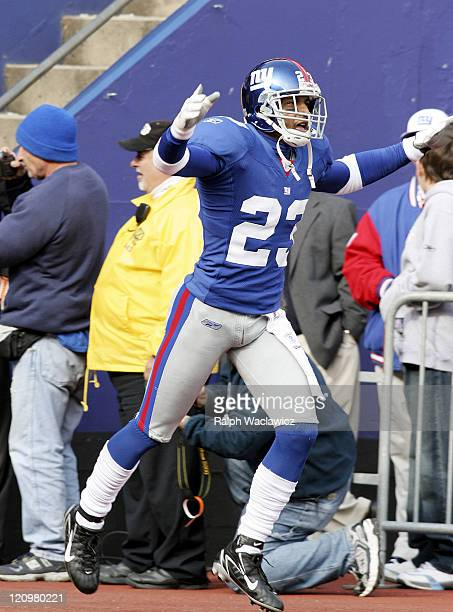 New York Giants cornerback Corey Webster comes out flying during player introductions prior to their their 14 to 10 victory over the Houston Texans...
