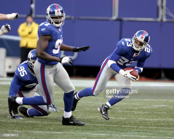New York Giants cornerback Corey Webster picks up a loose bal and runs with it during their 14 to 10 victory over the Houston Texans on November 5...
