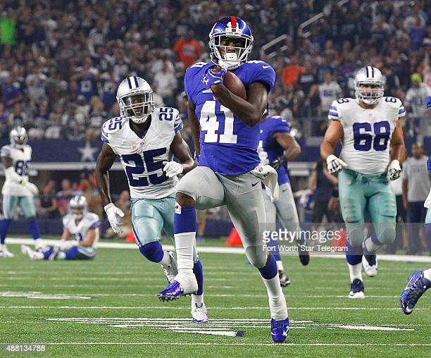 New York Giants cornerback Dominique RodgersCromartie runs for touchdown in the second quarter after a fumble by the Dallas Cowboys' Cole Beasley on...