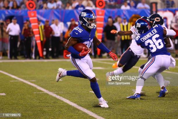 New York Giants defensive back Corey Ballentine returns a kickoff during the first quarter of the National Football League game between the New York...