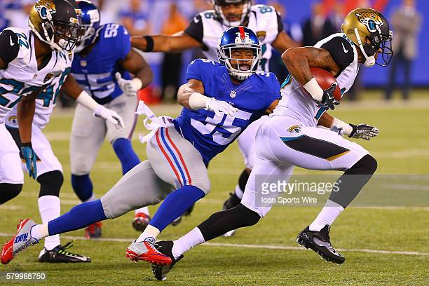 New York Giants defensive back Josh Gordy tries to tackle Jacksonville Jaguars wide receiver Rashad Greene during the first quarter of the game...