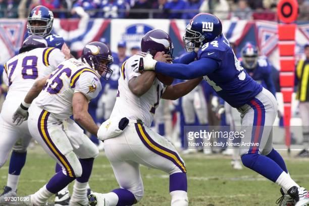New York Giants' defensive end Cedric Jones hits Minnesota Vikings quarterback Daunte Culpepper in the NFC Championship Game at Giants Stadium. The...