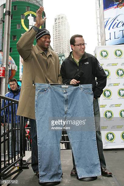 New York Giants Defensive End Michael Strahan and Jared Fogle, a Subway spokesperson, show off Fogle's old pants while celebrating 10 years of...