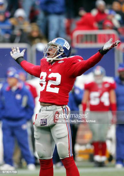 New York Giants' defensive end Michael Strahan celebrates after getting a sack in the third quarter against the Dallas Cowboys at Giants Stadium The...