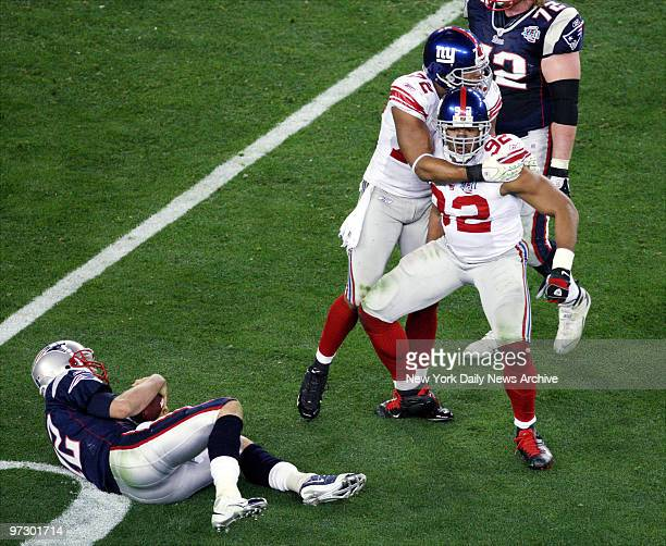 New York Giants' defensive end Michael Strahan celebrates after sacking New England Patriots' quarterback Tom Brady in the third quarter of Super...